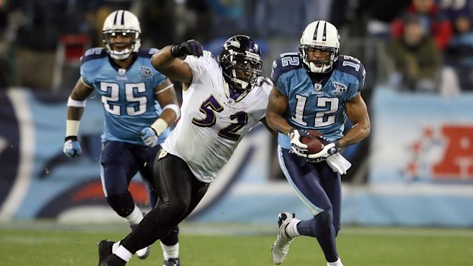 NASHVILLE, TN - JANUARY 10: Wide receiver Justin Gage #12 of the Tennessee Titans looks to avoid a tackle by Ray Lewis #52 of the Baltimore Ravens in the second quarter during the AFC Divisional Playoff Game on January 10, 2009 at LP Field in Nashville, Tennessee. (Photo by Andy Lyons/Getty Images)