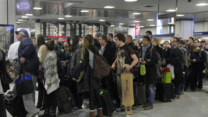 Passengers wait to board a train in New York's Penn Station, Wednesday, Nov. 21, 2012. Around 43.6 million Americans were expected to journey 50 miles or more between Wednesday and Sunday, just a 0.7 percent increase from last year, according to AAA's yearly Thanksgiving travel analysis. (AP Photo/Richard Drew)