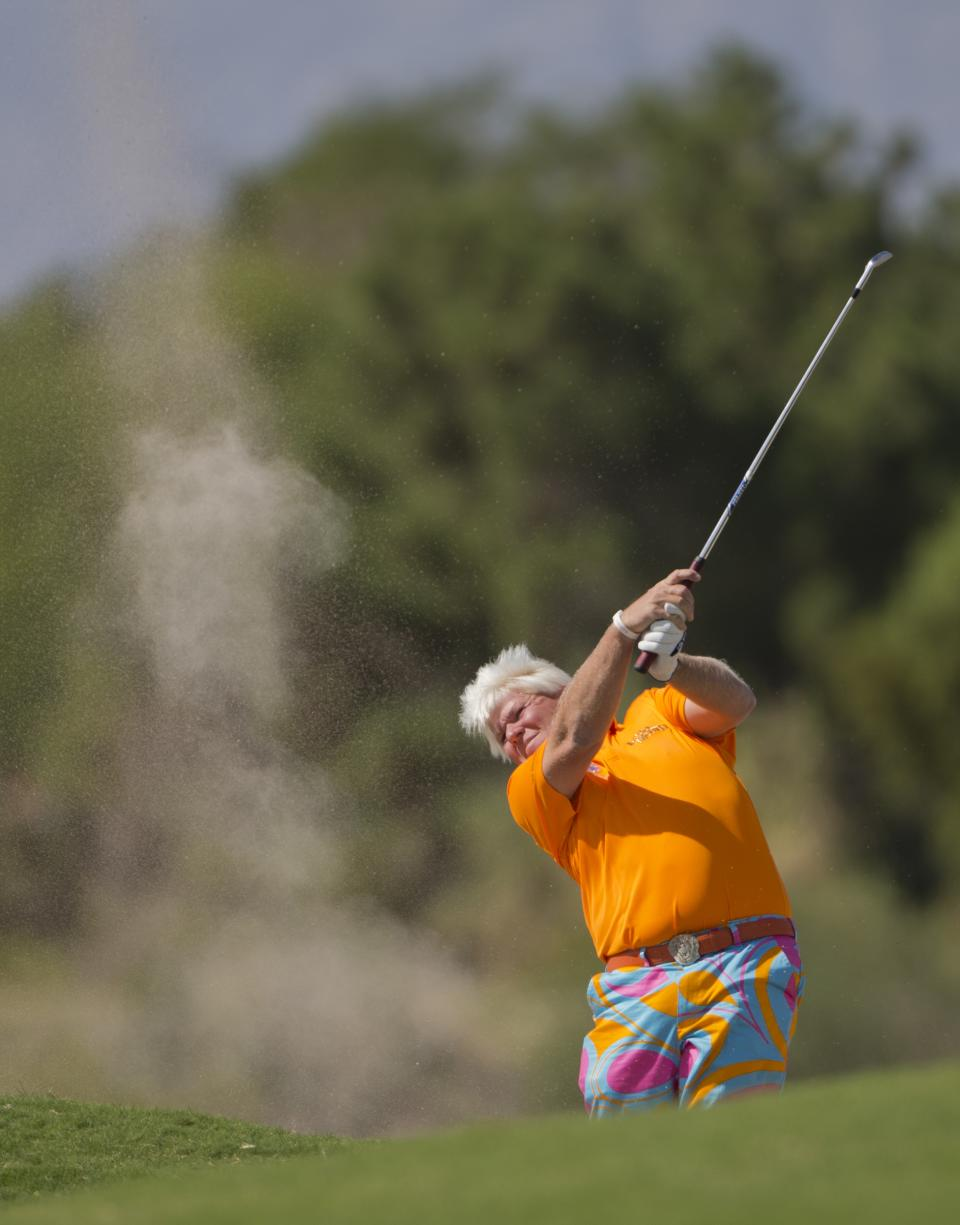 John Daly hits out of the bunker on the second hole during the third round of the Justin Timberlake Shriners Hospitals for Children Open golf tournament, Saturday, Oct. 6, 2012, in Las Vegas. (AP Photo/Julie Jacobson)