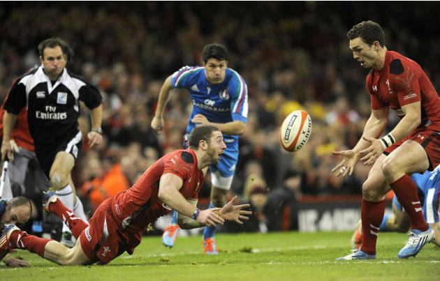 Wales' Alex Cuthbert passes the ball to George North during the Six Nations Championship rugby union match against Italy at the Millennium Stadium, Cardiff