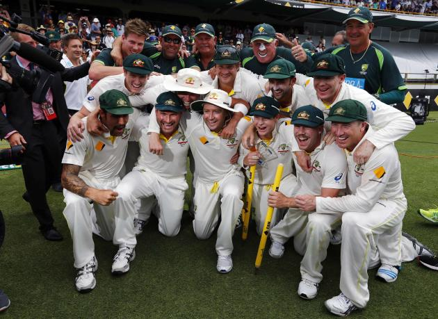 Australia's players pose for pictures after winning the Ashes test cricket series against England at the WACA ground in Perth