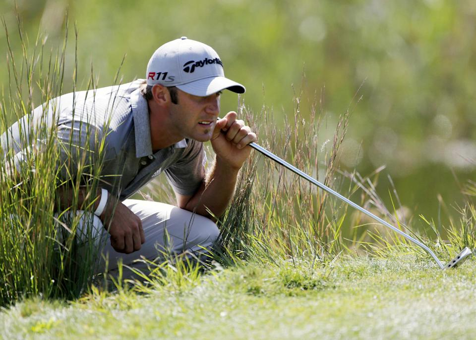 Dustin Johnson reads the green on the second hole during the final round of the Deutsche Bank Championship PGA golf tournament at TPC Boston in Norton, Mass., Monday, Sept. 3, 2012. (AP Photo/Michael Dwyer)