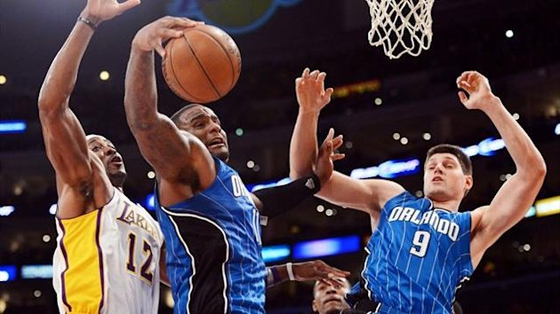 Orlando Magic's Glen Davis grabs a rebound from Dwight Howard of the LA Lakers (AFP)