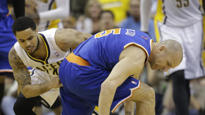 New York Knicks' Jason Kidd tries to maintain possession against Indiana Pacers' D.J. Augustin, left, during the second half of Game 4 of an Eastern Conference semifinal NBA basketball playoff series, on Tuesday, May 14, 2013, in Indianapolis. Indiana defeated New York 93-82. (AP Photo/Darron Cummings)