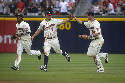 Minor's arm, bat lead Braves over Reds 5-2