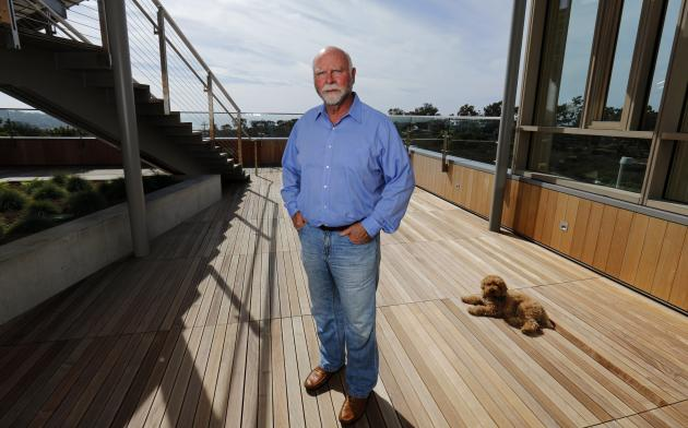 Genetic researcher Craig Venter is pictured with his dog Darwin, outside his office in La Jolla