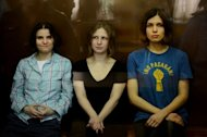 "Members of the all-girl punk band ""Pussy Riot"" Nadezhda Tolokonnikova (R), Maria Alyokhina (L) and Yekaterina Samutsevich (C)"