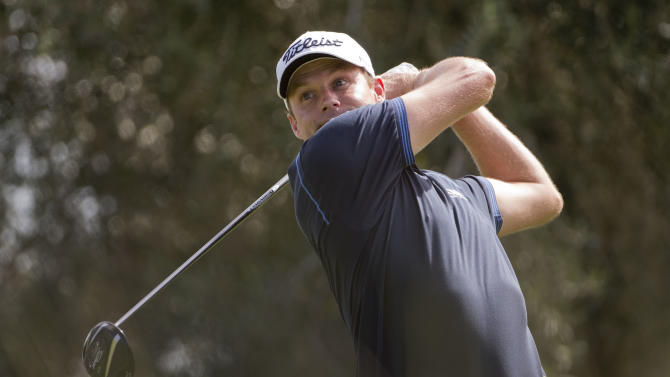 Nick Watney tees off the ninth hole in the first round during the Justin Timberlake Shriners Hospitals for Children Open golf tournament on Thursday, Oct. 4, 2012, in Las Vegas. (AP Photo/Julie Jacobson)