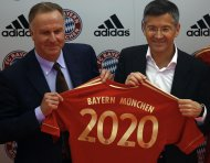 File photo of Karlheinz Rummenigge, CEO of FC Bayern Munich and Adidas' CEO Herbert Hainer (R) presenting the club's new soccer jersey in Munich April 19, 2011, after Bayern Munich extended its contract with the German sportswear brand Adidas until 2020. Champions League finalists Bayern Munich and Borussia Dortmund are the envy of soccer fans across Europe for the way the German clubs run their business as well as their success on the field. Bayern and Dortmund are the top two teams in the Bundesliga where clubs boast the largest crowds in Europe, keep ticket prices low, are largely profitable and have produced a crop of talented young players. TO GO WITH STORY SOCCER-CHAMPIONS/FINANCES REUTERS/Michael Dalder/Files    (GERMANY - Tags: SPORT SOCCER BUSINESS)