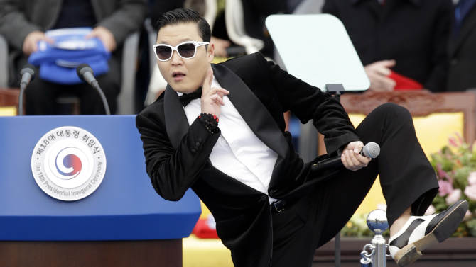 South Korean rapper PSY performs before President Park Geun-hye's presidential inauguration ceremony at the National Assembly in Seoul, South Korea, Monday, Feb. 25, 2013. Park became South Korea's first female president Monday, returning to the presidential mansion where she grew up with her dictator father.  (AP Photo/Lee Jin-man)
