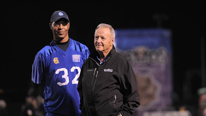 """IMAGE DISTRIBUTED FOR TOSTITOS:  From left, Former NFL player Marcus Allen and coach Bobby Bowden joined the """"Tostitos Homecoming Party Bowl"""" hosted at Cerritos College on Thursday, December 13, 2012 in Norwalk, Calif. The Tostitos brand surprised 28 unsuspecting veterans with the ultimate football party and star-studded event that included football greats, Bobby Bowden, Marcus Allen and actor/screenwriter, Owen Wilson. (Photo by Jordan Strauss/Invision for Tostitos/ AP Images))"""