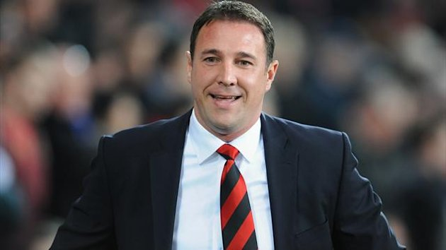 Malky Mackay's Cardiff lead third-placed Watford by 12 points with four games remaining
