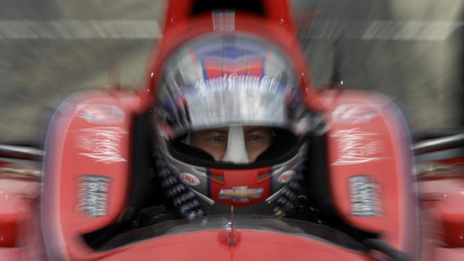 Marco Andretti sits in his car during a break in practice for the Indianapolis 500 auto race at the Indianapolis Motor Speedway in Indianapolis, Friday, May 17, 2013. (AP Photo/Darron Cummings)