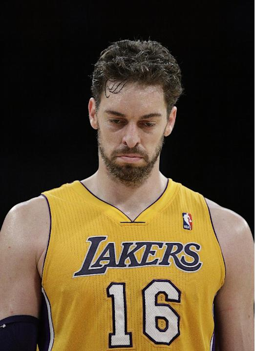 Los Angeles Lakers' Pau Gasol, of Spain, walks down the court during the first half of an NBA basketball game against the Los Angeles Clippers on Thursday, March 6, 2014, in Los Angeles