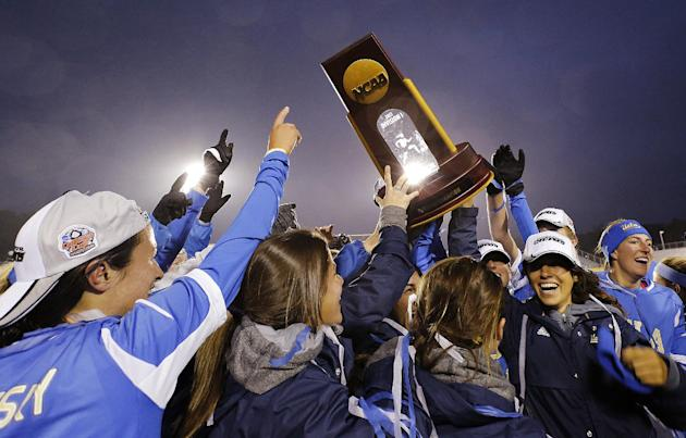 UCLA players, including Kodi Lavruskey, left, who scored the winning goal in overtime against Florida State celebrate after winning the championship soccer game at the NCAA Women's College Cup in