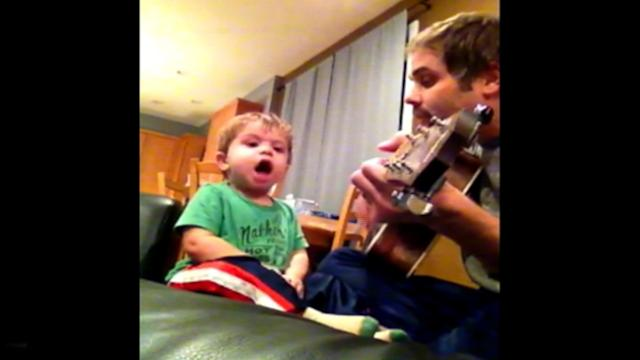 Dad, Toddler Son Sing a Duet for Mom