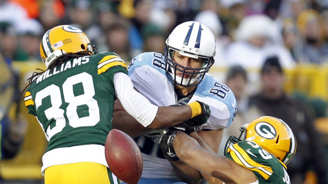 Green Bay Packers' Tramon Williams (38) and Brad Jones (59) break up a pass intended for Tennessee Titans' Craig Stevens (88) during the second half of an NFL football game Sunday, Dec. 23, 2012, in Green Bay, Wis. (AP Photo/Mike Roemer)