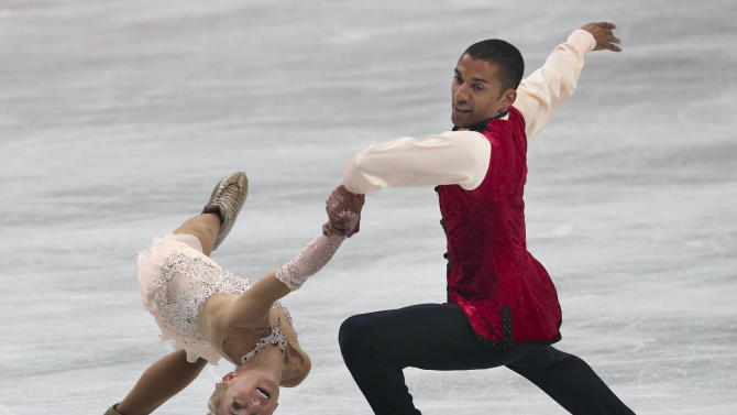 Aliona Savchenko and Robin Szolkowy of Germany perform during the pairs free skating in the World Figure Skating Championships in Saitama, near Tokyo, Thursday, March 27, 2014. The German pair wont the gold medal. (AP Photo/Koji Sasahara)
