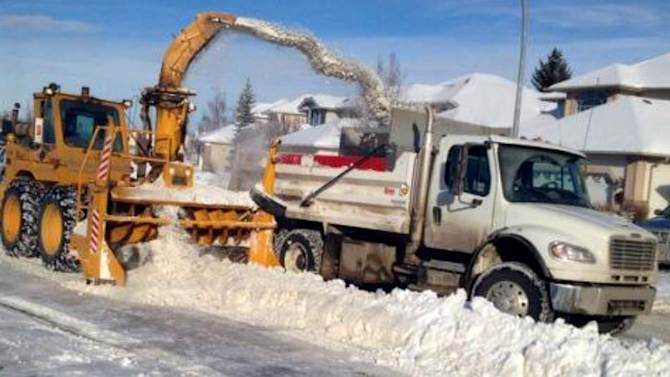 The city announced Monday it will focus resources on clearing snow-clogged streets after weeks of heavy snowfall saw plows focused on main roads.