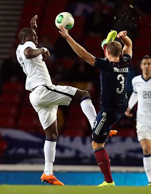 Scotland's Steven Whittaker, right, in action with United States' Jozy Altidore, left, during their international soccer match at Hampden Park, Glasgow, Scotland, Friday Nov. 15, 2013. (AP Photo/Scott Heppell)