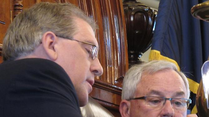 Kansas House Rules Committee Chairman Clark Shultz, left, a McPherson Republican, consults with House Speaker Mike O'Neal, right, a Hutchinson Republican, as the House considers an aggressive plan for cutting income and sales taxes, Wednesday, May 9, 2012 in Topeka, Kan.. (AP Photo/John Hanna)