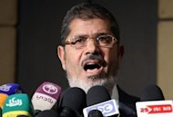 Muslim Brotherhood presidential candidate Mohamed Morsi speaks during a press conference in Cairo. Morsi is to become the first Islamist head of state in the Arab world&#39;s most populous nation after being declared winner in a divisive run-off with ex-premier Ahmed Shafiq
