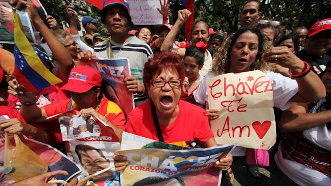 Supporters of Venezuela's President Hugo Chavez celebrate his return at Bolivar Square in Caracas, Venezuela, Monday, Feb. 18, 2013. Chavez returned to Venezuela early Monday after more than two months of treatment in Cuba following cancer surgery, his government said, triggering street celebrations by supporters who welcomed him home while he remained out of sight at the Carlos Arvelo Military Hospital in Caracas, where he will continue his treatment. (AP Photo/Fernando Llano)