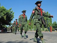 Myanmar military troops arrive in Sittwe, capital of Myanmar&#39;s western Rakhine state. Communal bloodshed in western Myanmar risks developing into &quot;armed terrorist acts&quot;, the government said Wednesday, after security forces were targeted by homemade firearms in deadly fighting