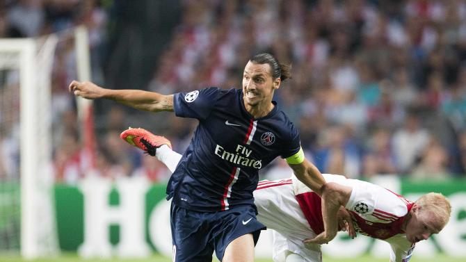 Paris St-Germain's Zlatan Ibrahimovic challenges Davy Klaassen of Ajax Amsterdam during their Champions League soccer match in Amsterdam