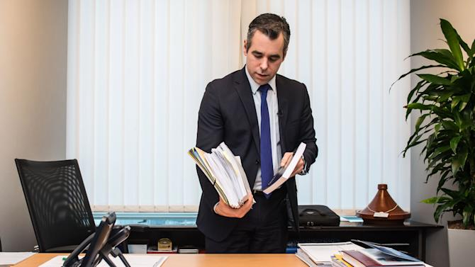 FOR STORY - EUROPE'S TRAVELING PARLIAMENT - Germany's Member of the European Parliament Alexander Alvaro, packs his documents, at his desk in the European Parliament building, in Brussels, on Friday, Feb. 1, 2013, ready to move to Strasbourg. The EU set up two parliaments, one at headquarters in Brussels, Belgium, and the other in Strasbourg, France, so in a whirl of trunks, trolleys and backpacks, hundreds of European Union parliamentarians and their staff move some 350-kilometer (220-mile) across the continent for four days of meetings, at an annual cost of about euro 1.3 billion (US dlrs 1.8 billion).  (AP Photo/Geert Vanden Wijngaert)