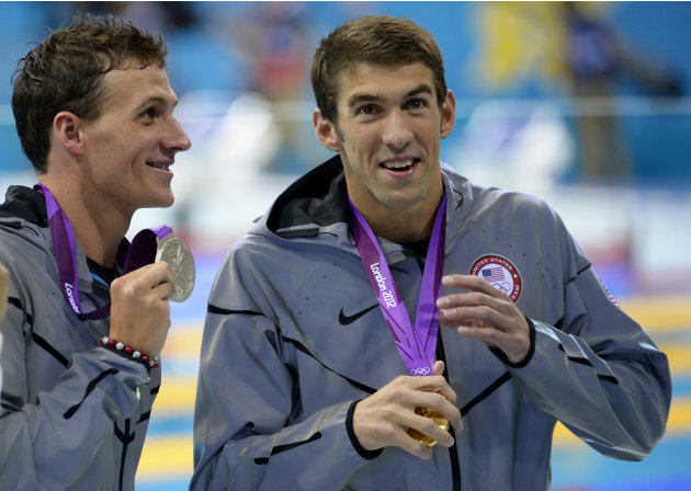 United States' Michael Phelps, right, and United States' Ryan Lochte pose with their medals for the men's 200-meter individual medley swimming final at the Aquatics Centre in the Olympic Park during t