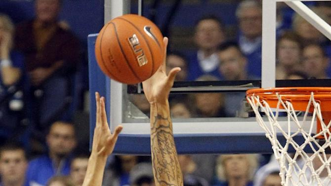 Kentucky's Willie Cauley-Stein, right, blocks the shot of Baylor's Isaiah Austin during the first half of an NCAA college basketball game at Rupp Arena in Lexington, Ky., Saturday, Dec. 1, 2012. (AP Photo/James Crisp)