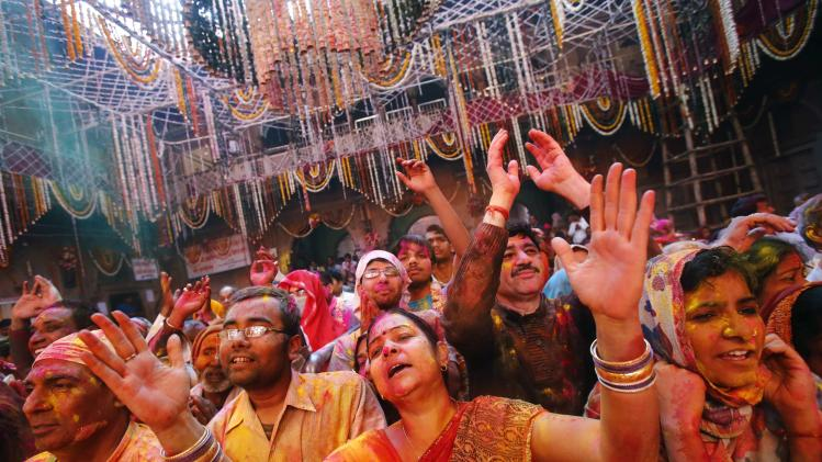 Hindu devotees daubed in colours sing hymns during Holi celebrations at the Bankey Bihari temple in Vrindavan