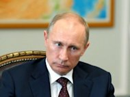 Russia&#39;s President Vladimir Putin chairs a meeting near Moscow on July 13. Russia&#39;s lower house of parliament on Friday approved a controversial bill that brands NGOs receiving funding from abroad as &quot;foreign agents&quot;, a law activists fear the Kremlin will use to target critics