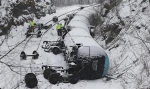 Emergency personnel examine the wreckage of a train derailment near Vandergrift