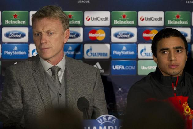 Manchester United's manager David Moyes, left, sits next to Rafael during a press conference at Old Trafford Stadium, Manchester, England, Monday, Dec. 9, 2013. Manchester United will play Shakhta