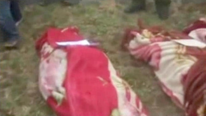 In this image taken from video obtained from the Sham News Network, which has been authenticated based on its contents and other AP reporting, shows bodies of some of the victims of an attack on the town of Sanamein, Syria lie on the ground during a funeral on Thursday, April 11, 2013. Syrian government forces launched a counteroffensive in the south, capturing the town and killing at least 45 people including women and children, opposition activists said Thursday. (AP Photo/Sham News Network via AP video)