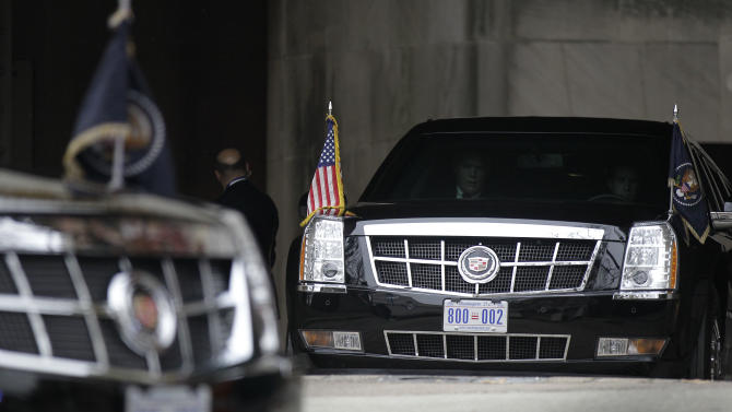 "FILE - In this Dec. 16, 2010 file photo, the presidential limousines are seen driving out of the Interior Department in Washington following an event. President Barack Obama's limousine will soon carry the District of Columbia's ""Taxation Without Representation"" license plate, a subtle protest of the lack of voting rights in Congress for the city's 632,000 residents.   (AP Photo/Pablo Martinez Monsivais)"