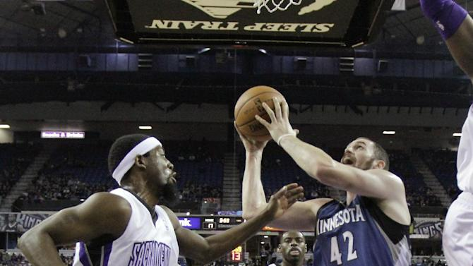 Minnesota Timberwolves forward Kevin Love, right, shoots against Sacramento Kings forward John Salmons, left, during the first quarter of an NBA basketball game in Sacramento, Calif., Tuesday, Nov. 27, 2012.(AP Photo/Rich Pedroncelli)