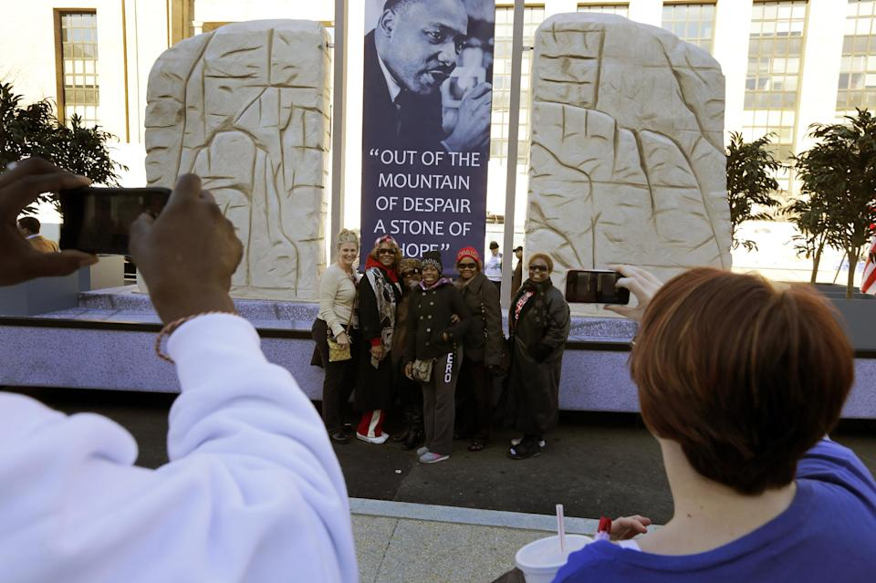 People take a picture of a group with the Martin Luther King float prepared for the 57th Presidential Inaugural Parade, Sunday, Jan. 20, 2013 in Washington. Thousands are planning to march in the 57th Presidential Inauguration parade after the ceremonial swearing-in of President Barack Obama on Monday. (AP Photo/Alex Brandon)