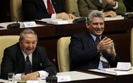 "Cuba's President Raul Castro and newly elected first vice president Miguel Diaz Canel, (R), attend the closing session of the National Assembly of the Peoples Power in Havana February 24, 2013. Castro announced on Sunday he would step down from power after his second term as president ends in 2018, and the new parliament named a 52-year-old rising star to become his first vice president and most visible successor. Castro, 81, made the announcement in a nationally broadcast speech shortly after the Cuban National Assembly elected him to a second five-year term in the opening session of the new parliament. ""This will be my last term,"" Castro said. REUTERS/Desmond Boylan"