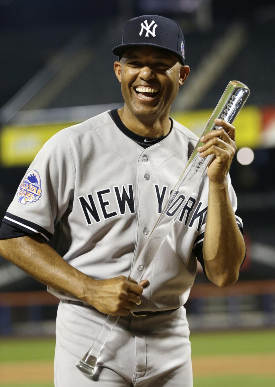 American League's Mariano Rivera, of the New York Yankees, poses with the MVP trophy after the MLB All-Star baseball game, on Tuesday, July 16, 2013, in New York. The American League defeated the National League 3-0. (AP Photo/Kathy Willens)
