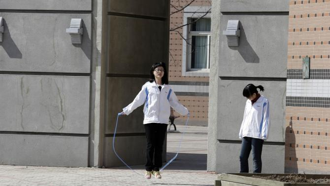 A Chinese student exercise with a skipping rope in the Northeast Yucai school where one of the victims of Boston Marathon explosions, Lu Lingzi, studied during her high school education, in Shenyang, north eastern China's Liaoning province, Thursday, April 18, 2013. Lu, who was killed in the Boston Marathon blasts, grew up in an intellectual family in a provincial capital with gritty, industrial roots, and graduated from a highly competitive high school that routinely sends students abroad. (AP Photo/Ng Han Guan)