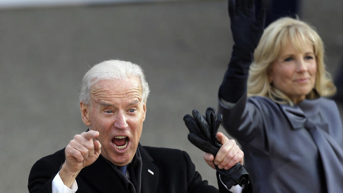 FILE - In this Jan. 21, 2013, photo, Vice President Joe Biden reacts with his wife, Jill, as they walk down Pennsylvania Avenue en route to the White House, Monday, Jan. 21, 2013, in Washington, during the Inaugural Parade during the 57th Presidential Inauguration parade after the ceremonial swearing-in of President Barack Obama. Biden in 2016? The inauguration is barely over but the vice president already is dropping plenty of hints that he might have another political act. Biden packed his schedule with events and receptions attended by party stalwarts throughout the long weekend of inauguration festivities, stoking speculation he may be laying the groundwork to carry the torch from Obama.  (AP Photo/Gerald Herbert)
