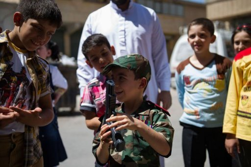 A young Syrian boy stands with a toy pistol on the first day of Eid al-Fitr, marking the end of the holy fasting month of Ramadan, in the town of Marea in northern Syria on August 19, 2012. The United Nation's troubled observer mission to Syria has officially ended after being recalled amid escalating violence as world powers fail to agree how to end months of bloodshed in the country
