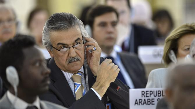 Faysal Khabbaz Hamoui, Syrian Ambassador in Geneva, listens before the vote after the Syria draft resolution was just adopted by the Council during the 21th session of the Human Rights Council at the European headquarters of the United Nations in Geneva, Switzerland, Friday, Sept. 28, 2012. The U.N.'s top human rights body on Friday extended by six months the mission of its independent expert panel probing alleged war crimes in Syria's 18-month conflict. (AP Photo/Keystone, Martial Trezzini)