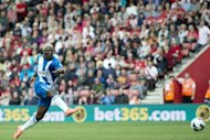 Wigan's striker Arouna Kone shoots to score during their English Premier League football match against Southampton at St Mary's Stadium in Southampton. Wigan won 2-0