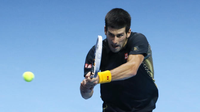 Novak Djokovic of Serbia plays a return to Jo-Wilfried Tsonga of France during their singles tennis match at the ATP World Tour Finals in London Monday, Nov. 5, 2012. (AP Photo/Kirsty Wigglesworth)