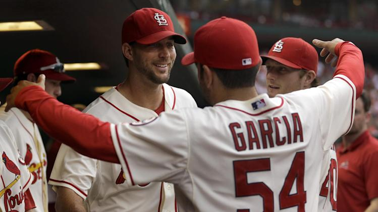 Sitting atop NL, Cardinals await opponent