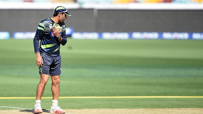 Pakistan captain Misbah-ul Haq does a shadow batting practice on the pitch during their training session ahead of the 2015 Cricket World Cup Pool B match between Pakistan and Zimbabwe at the Gabba Cricket Stadium in Brisbane on February 28, 2015